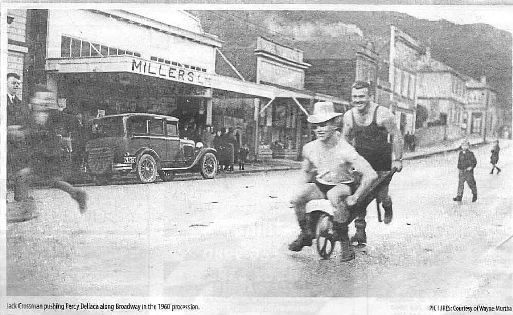 Percy Dellaca being wheeled down the street in Westport